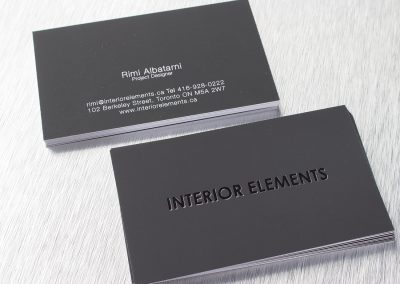 Black colour foil stamp on Suede business card